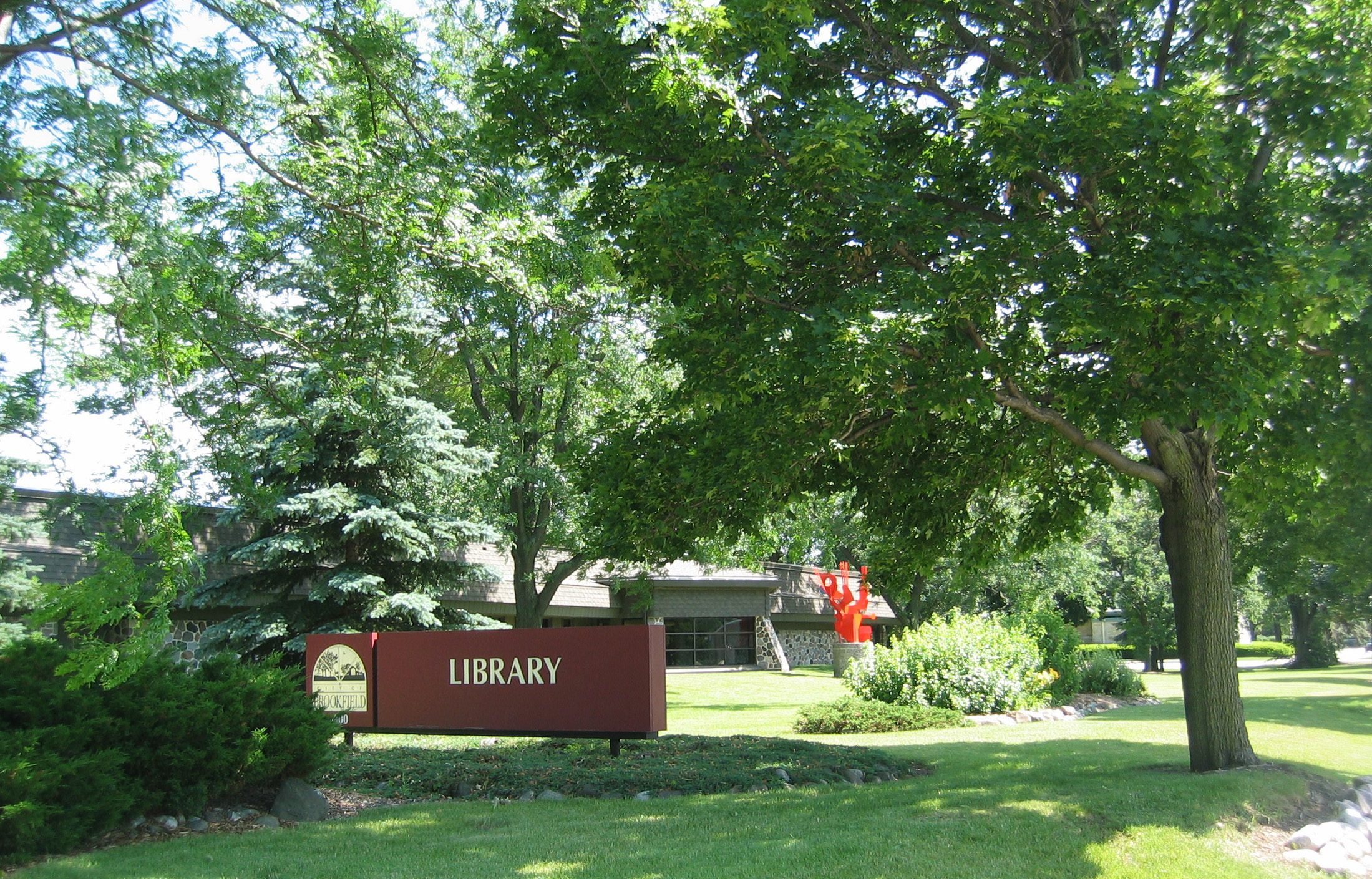 Front view of the Brookfield Public Library with Guido Brink sculpture